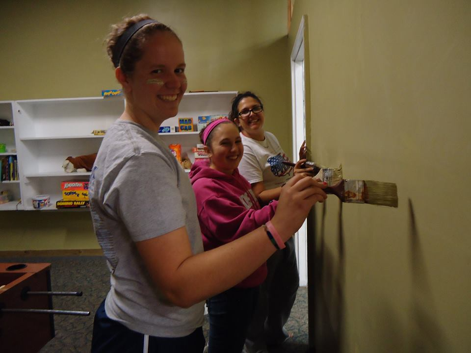 Jayme Babczak (front) co-led an Agape Center service trip to Camden, NJ in October 2014.